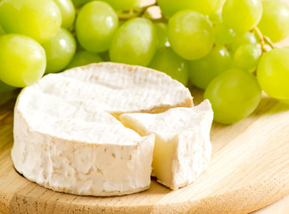 Still life of cheese and grapes