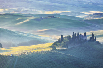 Foggy dawn over rural house in San Quirico d'Orcia, Tuscany
