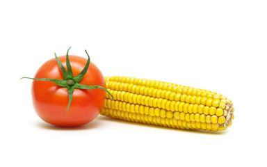 corn and tomato isolated on white background close-up