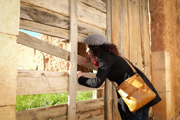 Woman looking through the wall