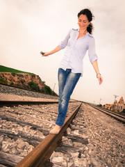 Woman walking on rail track