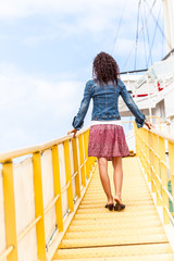 Woman boarding a ship by the gangway