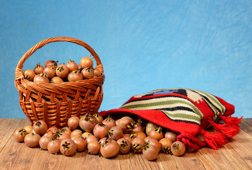 Medlar in a wicker basket and in a etno bag
