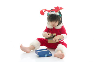 Cute asian baby wearing santa costume with present