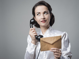 Vintage secretary on the phone with envelope