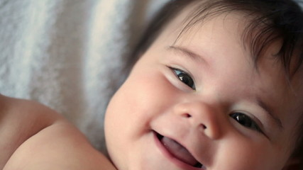 5-month girl is smiling