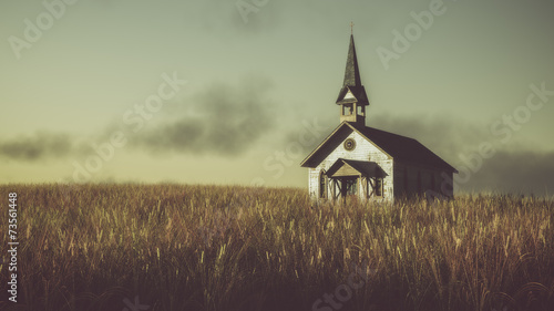 Old abandoned white wooden chapel on prairie at sunset with clou - 73561448