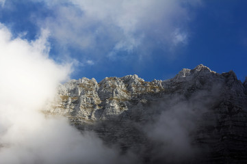 Montasio mountain, Italy, surrounded by clouds