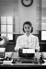 Smiling secretary at work