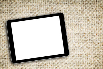 blank digital tablet on fabric background