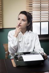 Pensive secretary with typewriter