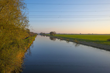 Cables over a canal at sunset in autumn