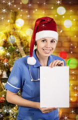 Portrait of smiling doctor woman in santa hat. Doctor - christma