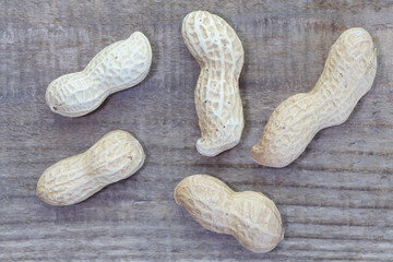 Close - up Raw dried peanut on wood table