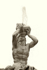detail of triton fountain in rome black and white