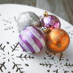 Christmas decoration on wooden table (vintage color toned image)