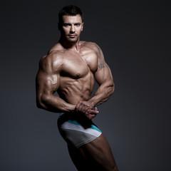 Bodybuilder posing in the studio