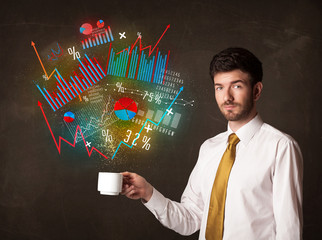 Businessman holding a white cup with diagrams and graphs