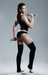 Female exerciser weights