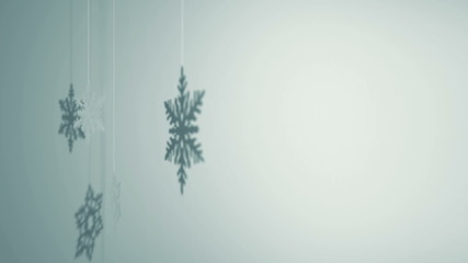 Three paper snowflakes hanging and rotating decoration