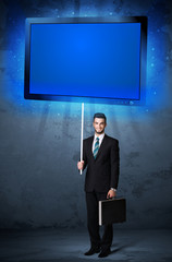 Businessman with shining tablet
