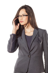 pretty young businesswoman listen carefully to the phone