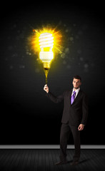 Businessman with an eco-friendly bulb