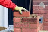 Bricklaying - laying a brick