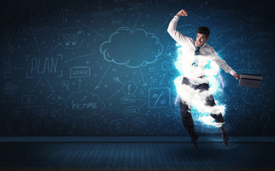 Happy business man jumping with storm cloud around him