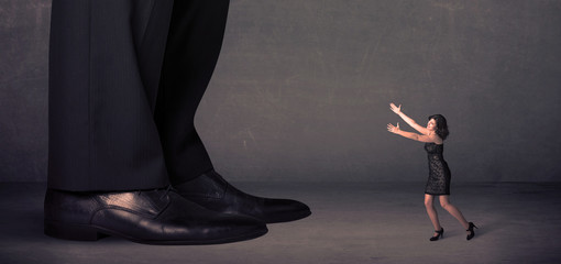 Huge legs with small businesswoman standing in front concept
