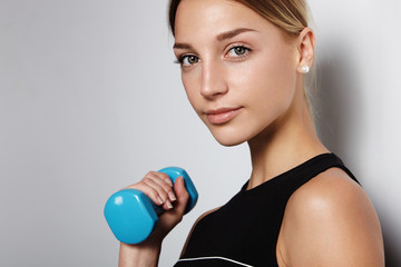 portrait of a woman holding barbell