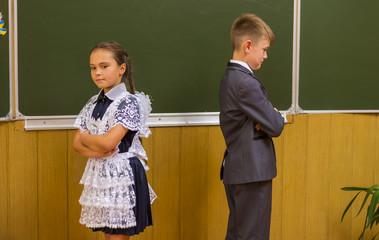 girl and boy near blackboard