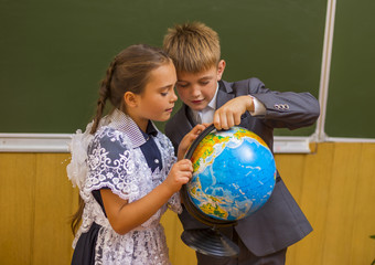 girl and boy with globe