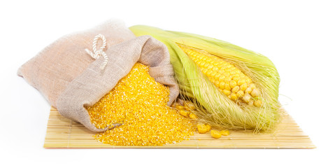 Composition from corn, maize flour in sack on the mat