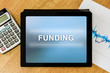funding word on digital tablet