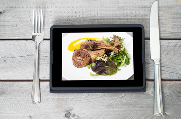 Online ordering food concept with table setting and meal course