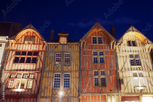 tenement houses in old town of Troyes at night, France.