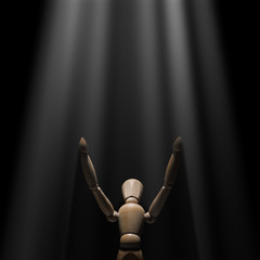 Wooden mannequin raised hands to light