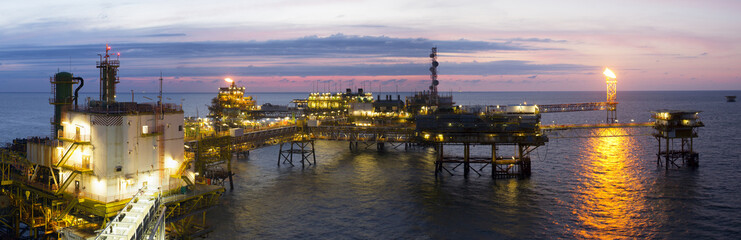 An offshore platform at sunset