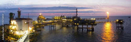 An offshore platform at sunset - 73573854