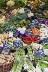 Vegetables priced up and displayed on a market stall