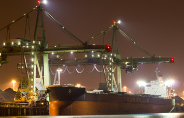 A large bulk carrier supplying iron-ore in a harbor