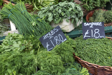 A display of various herbs on a market stall