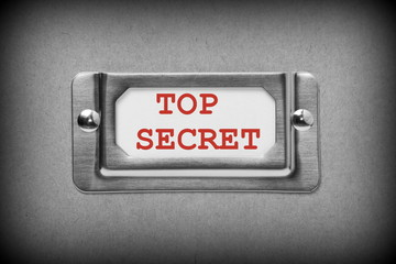 Top Secret drawer label in black and white with red text