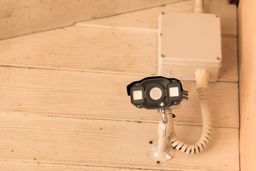 Close up image of surveillance cameras on the wall