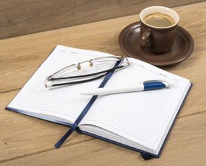 Notebook coffee and pen