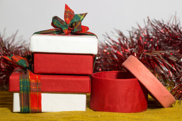 Red, pink and white paper Christmas present boxes
