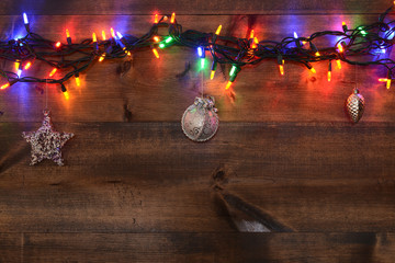 three silver ornaments and christmas lights