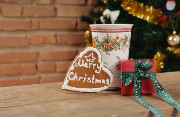 cute cookie and small gift with cinamon cup of tea for Christmas