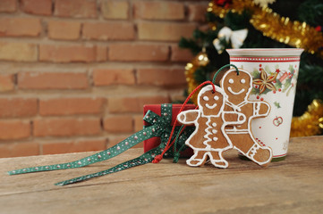 cute cookies and small gift with cinamon cup of tea for Christma